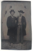 Two Western Men Wearing Long Coats and Hats Tintype