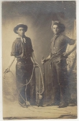 Cowboys with Guns, Rope, and Chaps Postcard