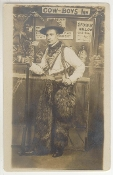 Cowboy Holding Musket Wearing Woolie Chaps Postcard