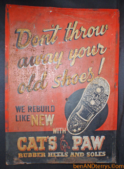 Cat's Paw Rubber Heels embossed Tin Sign