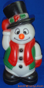 Snowman Tipping Top Hat Wearing Red Scarf & Green Vest BlowMold